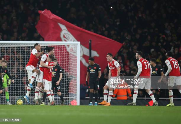 Arsenal players celebrate their second goal scored by Sokratis during the Premier League match between Arsenal FC and Manchester United at Emirates...
