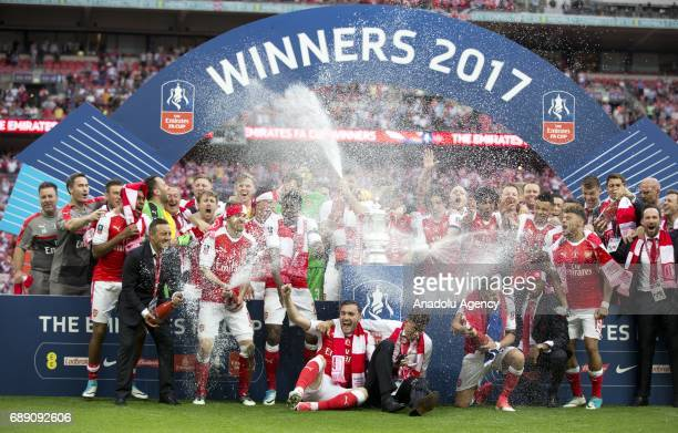 Arsenal players celebrate their victory against Chelsea FC in the FA Cup final at Wembley Stadium on May 27 2017 in London United Kingdom