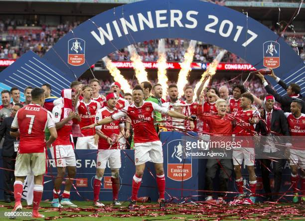 Arsenal players celebrate their victory against Chelsea FC in the FA Cup final at Wembley Stadium on May 27, 2017 in London, United Kingdom.