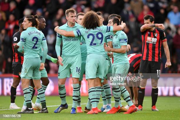 Arsenal players celebrate victory following the Premier League match between AFC Bournemouth and Arsenal FC at Vitality Stadium on November 25 2018...