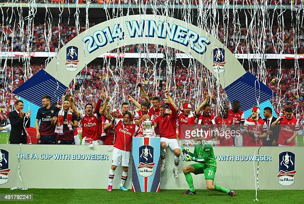 Arsenal players celebrate victory with the trophy after the FA Cup with Budweiser Final match between Arsenal and Hull City at Wembley Stadium on May...