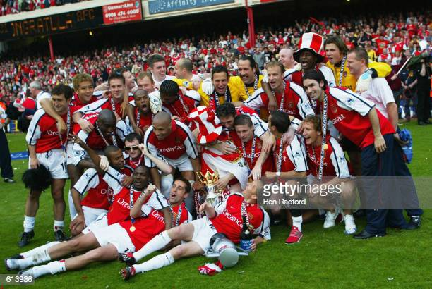 Arsenal players celebrate winning the league after the FA Barclaycard Premiership match between Arsenal and Everton played at Highbury in London on...