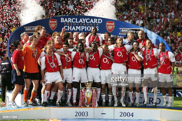 Arsenal players celebrate winning the Premiership during the FA Barclaycard Premiership match between Arsenal and Leicester City at Highbury on May...