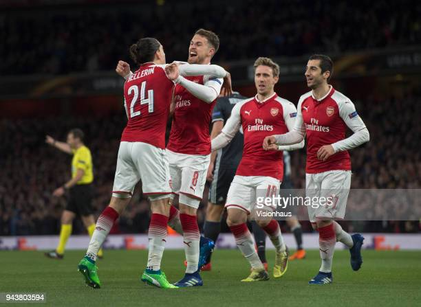 Arsenal players celebrate with goalscorer Aaron Ramsey during the UEFA Europa League Quarter final 1st Leg match between Arsenal and CSKA Moscow at...