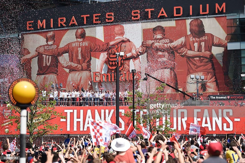 Arsenal players celebrate with the FA Cup outside the Emirates Stadium as part of their victory parade in London on May 18, 2014, following their win in the English FA Cup final football match on May 17, 2014 against Hull City. Aaron Ramsey insists Arsenal's dramatic FA Cup final victory will be the springboard for more glory now the Gunners have finally ended their trophy drought. Ramsey scored the extra-time goal that clinched a 3-2 win over Hull in Saturday's clash at Wembley, putting silverware back in the Arsenal trophy cabinet for the first time since 2005.