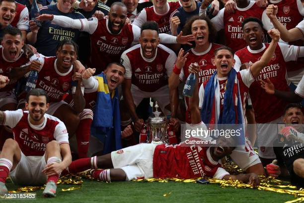 Arsenal players celebrate with the FA Cup Trophy after their teams victory in the Heads Up FA Cup Final match between Arsenal and Chelsea at Wembley...