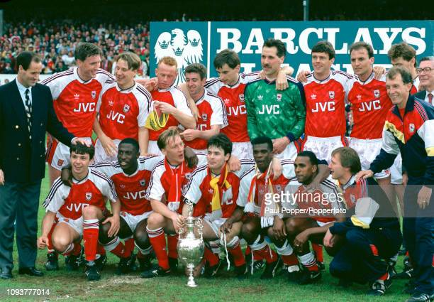 Arsenal players celebrate with the League Championship trophy after the final Barclays League Division One match of the season between Arsenal and...