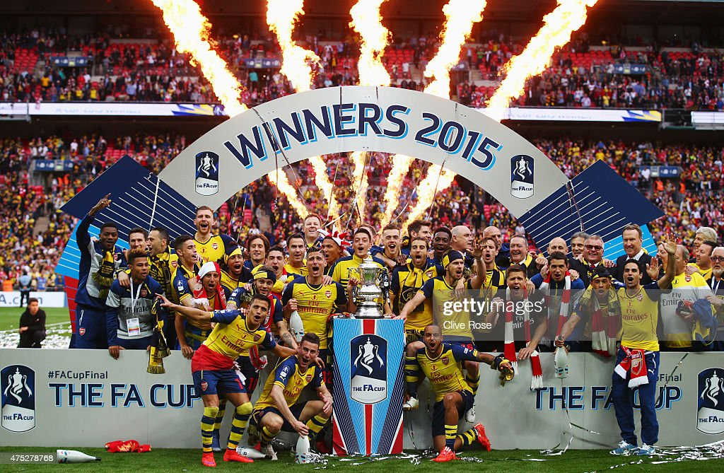 Arsenal players celebrate with the trophy after the FA Cup Final between Aston Villa and Arsenal at Wembley Stadium on May 30, 2015 in London, England. Arsenal beat Aston Villa 4-0.