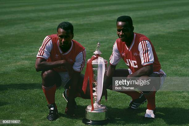 Arsenal players David Rocastle and Michael Thomas with the Littlewoods Cup after their team won the Football League Cup final beating Liverpool 21 at...