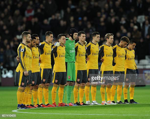 Arsenal players during the minutes silence before the match in honour of the Brazilian football team that died in a plane crash in Colombia the...