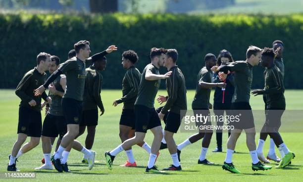 Arsenal players, including Arsenal's Swiss defender Stephan Lichtsteiner Arsenal's Armenian midfielder Henrikh Mkhitaryan , Arsenal's Swiss...