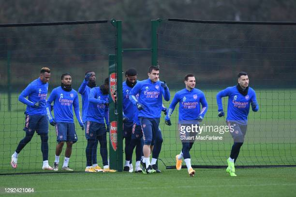 Arsenal players jog out before a training session at London Colney on December 21, 2020 in St Albans, England.