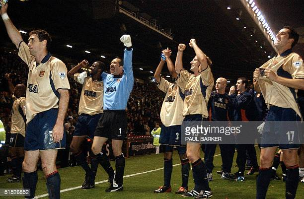 Arsenal players Martin Keown captain Patrick Vieirakeeper David Seaman Ashley ColeRay Parlour and Edu celebrate after a premier league match win over...