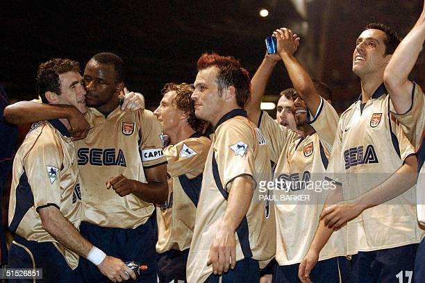 Arsenal players Martin Keown captain Patrick VieiraRay Parlour Frederik Ljungberg Ashley Cole and Edu celebrate after a premier league match win over...