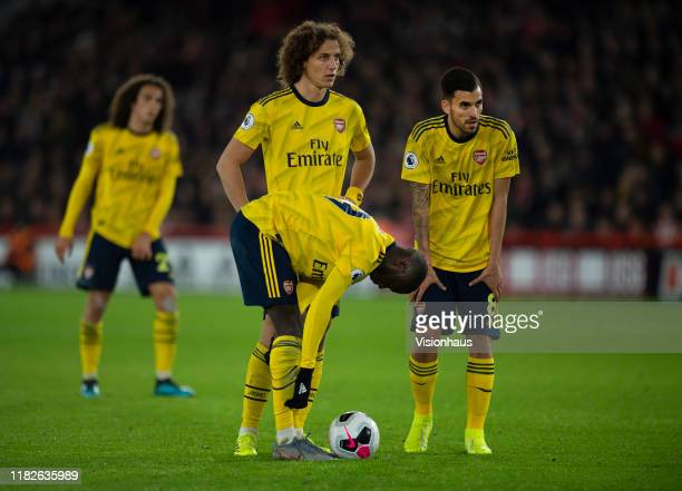 Arsenal players Nicolas Pepe, David Luiz, Dani Ceballos and Matteo Guendouzi line up a free kick during the Premier League match between Sheffield...
