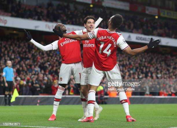 Arsenal players Nicolas Pepe Hector Bellerin and goal scorer PierreEmerick Aubameyang celebrate the winning goal during the Premier League match...