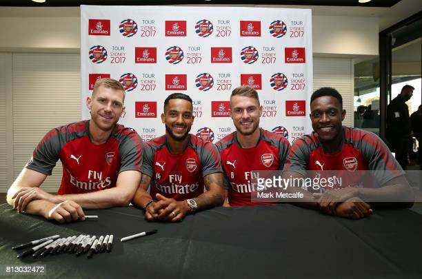 Arsenal players Per Mertesacker Aaron Ramsey Theo Walcott and Dany Welbeck pose during the Emirates Kids Clinic with Arsenal FC at Sydney University...
