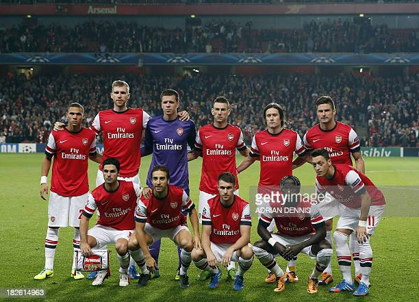 Arsenal players pose for a team photo before the UEFA Champions League Group F football match against SSC Napoli at the Emirates Stadium North London...