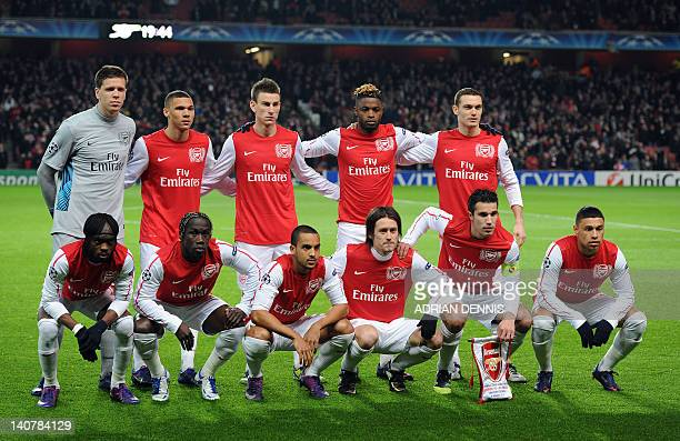 Arsenal players pose for a team picture before an UEFA Champions League round of 16 second leg football match against AC Milan at the Emirates...
