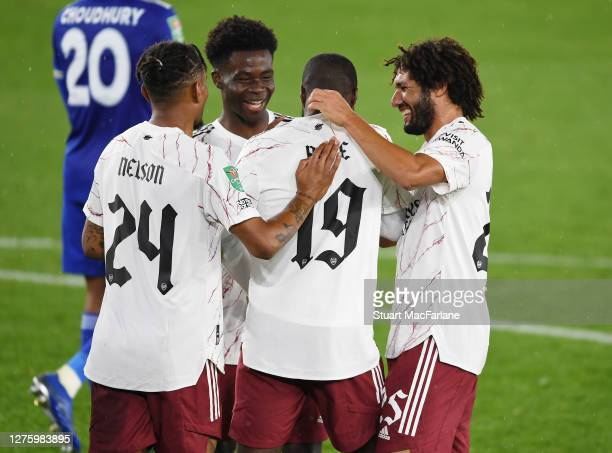 Arsenal players Reiss Nelson Bukayo Saka Nicolas Pepe and Mo Elneny celebrate the 1st goal during the Carabao Cup Third Round match between Leicester...