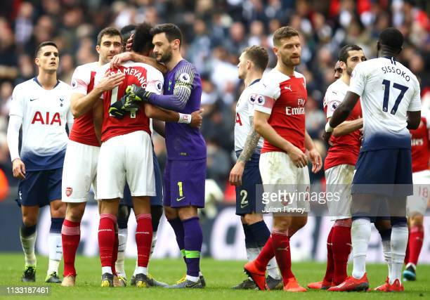 Arsenal players shake hands with Tottenham Hotspur players following the Premier League match between Tottenham Hotspur and Arsenal FC at Wembley...