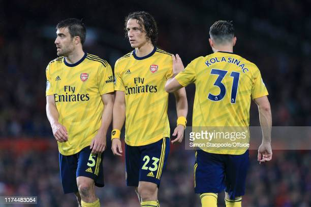 Arsenal players Sokratis Papastathopoulos David Luiz and Sead Kolasinac form a defensive wall during the Premier League match between Manchester...