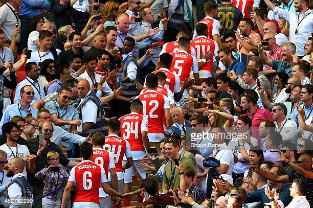 Arsenal players walk to the stand after their 10 win in the FA Community Shield match between Chelsea and Arsenal at Wembley Stadium on August 2 2015...