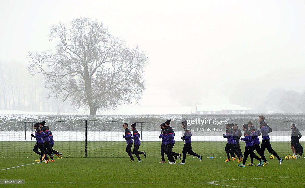Arsenal players warm up before a training session at London Colney on January 22, 2013 in St Albans, England.