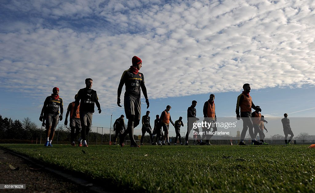 Arsenal players warm up before a training session at London Colney on January 18, 2017 in St Albans, England.