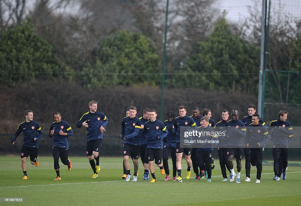 Arsenal players warm up during a training session ahead of their UEFA Champions League match against FC Bayern Muenchen at London Colney on February 18, 2013 in St Albans, England.