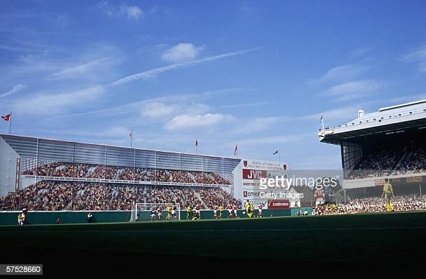 Arsenal playing Norwich City at the Arsenal Stadium Highbury 15th August 1992 the mural depicting Arsenal fans covers building work on the new North...