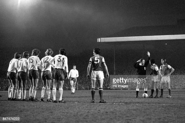 Arsenal prepare to take a free kick as the Ajax wall line up