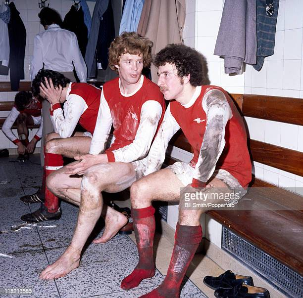 Arsenal striker Alan Sunderland with defender Willie Young in the dressing room at Highbury after their FA Cup 4th round match against Wolverhampton...