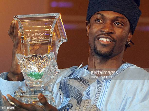 Arsenal striker and Togolese skipper Emmanuel Adebayor raise his trophy after being named African footballer of the year at the Confederation of...