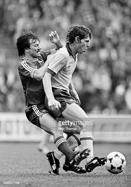 Arsenal striker Clive Allen is tackled from behind by Aberdeen defender Stuart Kennedy during their preseason match at Pittodrie Stadium in Aberdeen...
