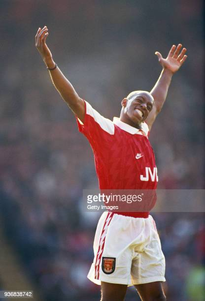 Arsenal striker Ian Wright celebrates a goal during the Premiership match against Wimbledon at Selhurst Prk on October 8 1994 in London England