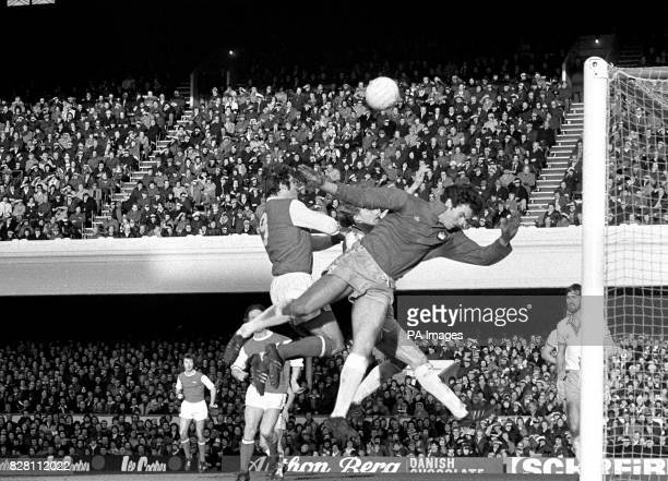 Arsenal striker Malcolm Macdonald and West Ham goalkeeper Mervyn Day jump for a high ball in the London 'derby' First Division Match at Highbury