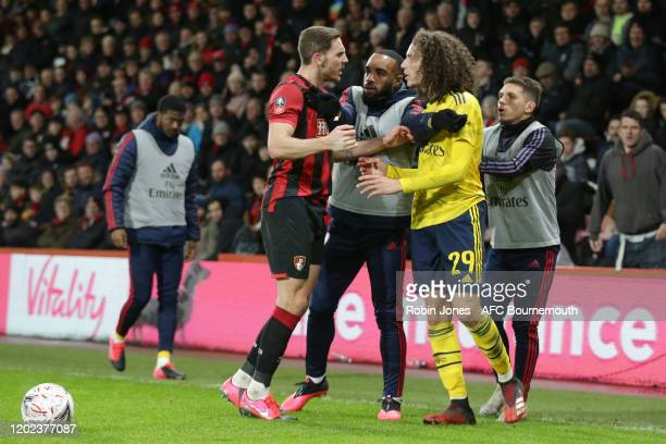 Arsenal subs Alexandre Lacazette and Lucas Torreira get between Dan Gosling of Bournemouth and Matteo Guendouzi of Arsenal during an altercation in...