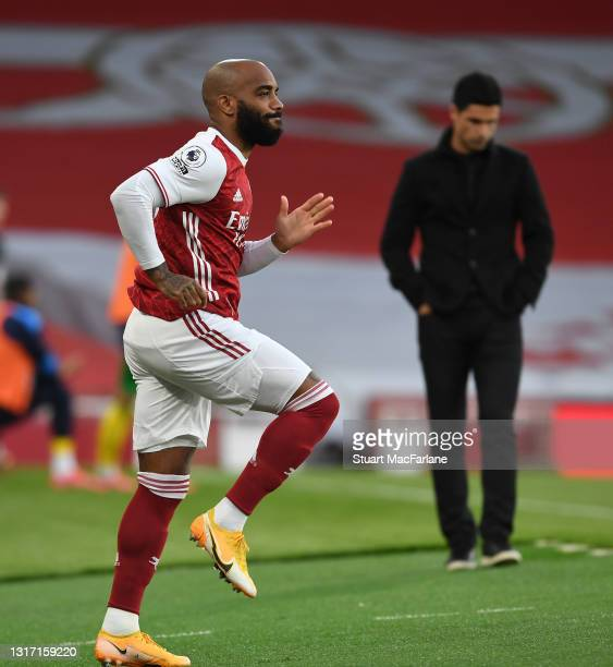 Arsenal substitute Alex Lacazette warms up during the Premier League match between Arsenal and West Bromwich Albion at Emirates Stadium on May 09,...