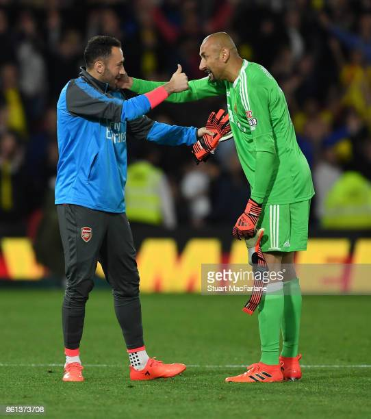 Arsenal substitute goalkeeper David Ospina with Watford goalkeeper Heurelho Gomes after the Premier League match between Watford and Arsenal at...