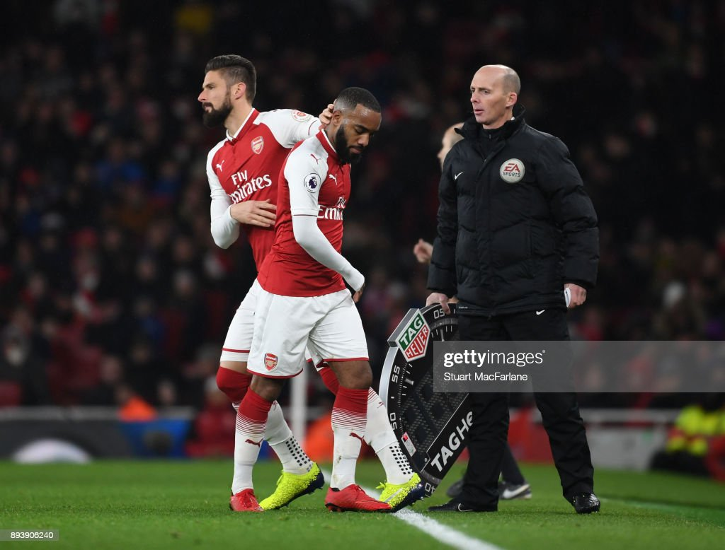 Arsenal substitute Oliver Giroud comes on for (R) Alex Lacazette during the Premier League match between Arsenal and Newcastle United at Emirates Stadium on December 16, 2017 in London, England.