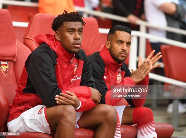 Arsenal substitutes Alex Iwobi and Theo Walcott before the Premier League match between Arsenal and AFC Bournemouth at Emirates Stadium on September...