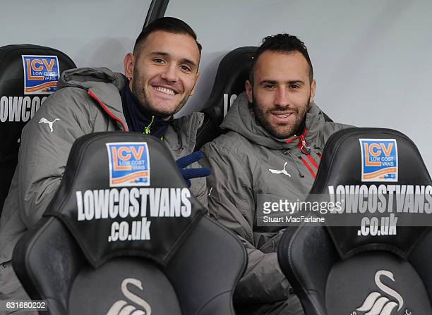 Arsenal substitutes Lucas Perez and David Ospina before the Premier League match between Swansea City and Arsenal at Liberty Stadium on January 14...