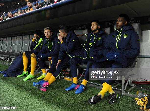 Arsenal substitutes Nacho Monreal Gabriel Theo Walcott and Danny Welbeck before the UEFA Champions League Round of 16 first leg match between FC...