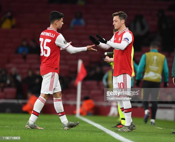 Arsenal substitution Mesut Ozil comes on for Gabriel Martinelli during the UEFA Europa League group F match between Arsenal FC and Eintracht...