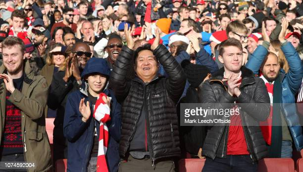 Arsenal supporters celebrate the first goal during the Premier League match between Arsenal FC and Burnley FC at Emirates Stadium on December 22 2018...