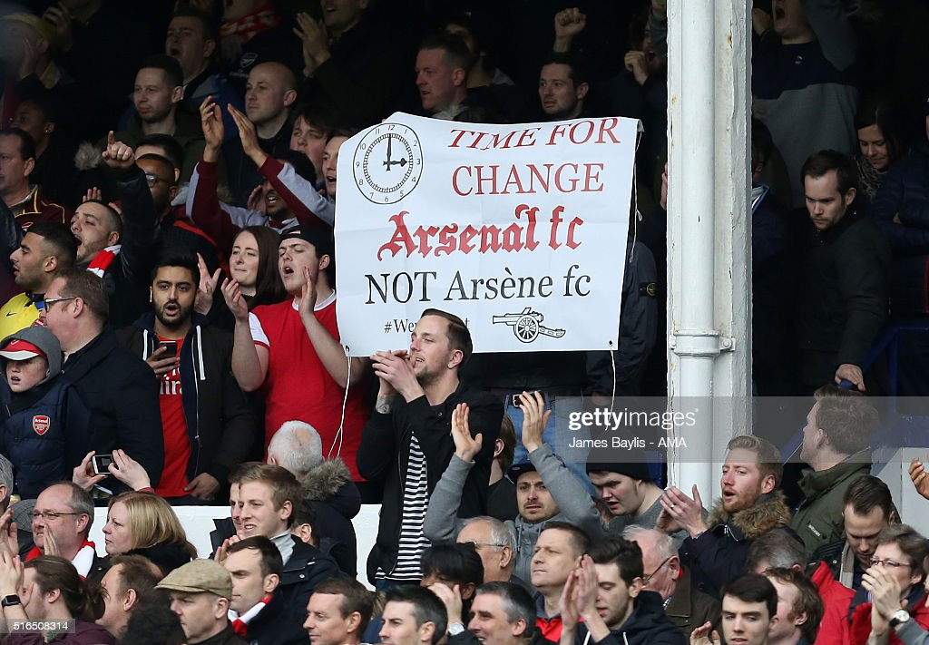 Arsenal supporters hold up a banner saying 'Time for change Arsenal FC NOT Arsene fc' during the Barclays Premier League match between Everton and Arsenal at Goodison Park on March 19, 2016 in Liverpool, England.