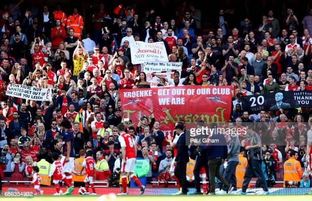 Arsenal supporters hold up banners during the Premier League match between Arsenal and Everton at Emirates Stadium on May 21 2017 in London England