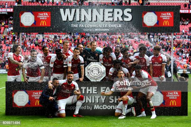 Arsenal team celebrate with the trophy following the The FA Community Shield final between Chelsea and Arsenal at Wembley Stadium on August 6 2017 in...