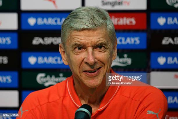 Arsenal team manager Arsene Wenger speaks during the Barclays Asia Trophy post match conference between Arsenal and Singapore Select XI at National...